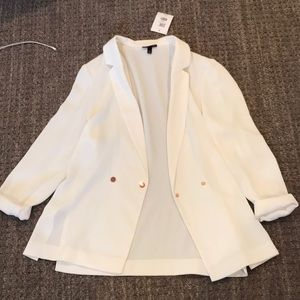 white blazer with rose gold buttons.